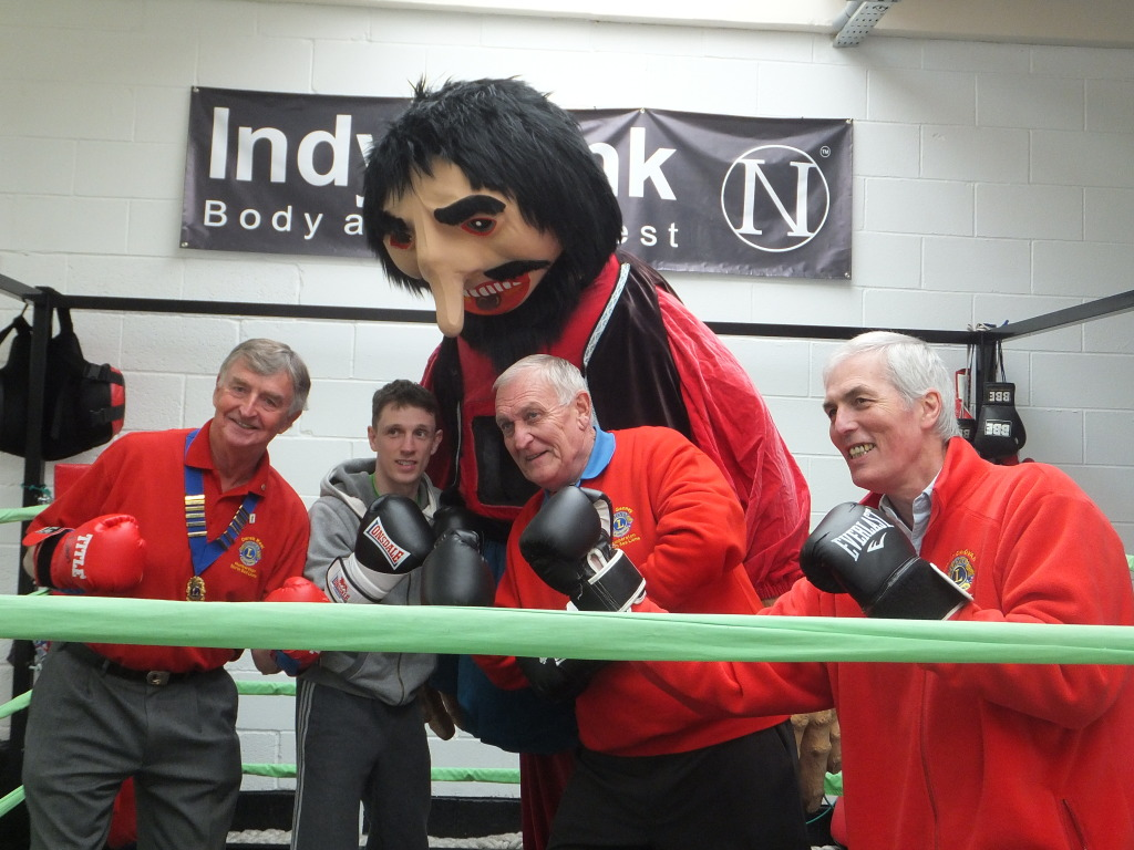 B) KO initial marketing January 2015 - President 2014-15 Derek Keal, Professional boxer Wayne Bloy, Giant (Lion Clive Todd), Event Organisers Clive Genney & Tim Donovan